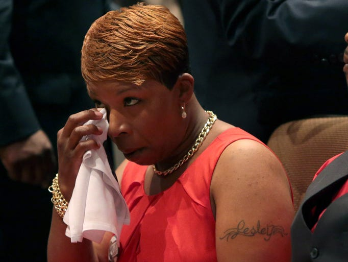 ST. LOUIS, MO - AUGUST 25:  Lesley McSpadden wipes her eye during the funeral services for her son Michael Brown inside Friendly Temple Missionary Baptist Church on August 25, 2014 in St. Louis Missouri.