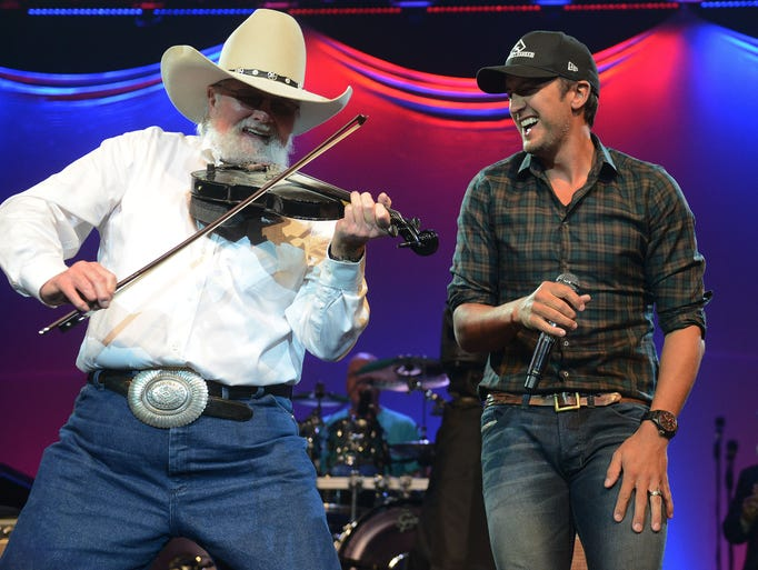 """Luke Bryan joins Charlie Daniels as he performs """"The Devil Went Down to Georgia"""" at Daniels' Scholarship for Heroes Concert Tuesday, March 25, 2014 at Lipscomb University in Nashville, Tenn."""