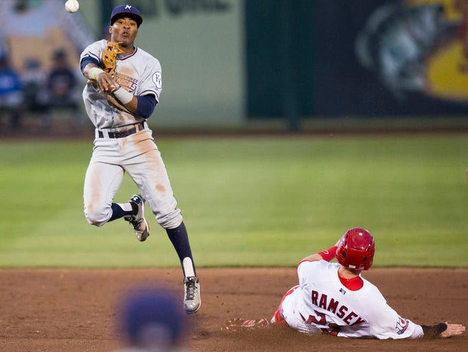 Northwest Arkansas Naturals shortstop Angel Franco (22) leaps while turning a double play during Friday's minor league baseball game against the Springfield Cardinals at Hammons Field on May 2, 2014 in Springfield. (David Welker/For the News-Leader)