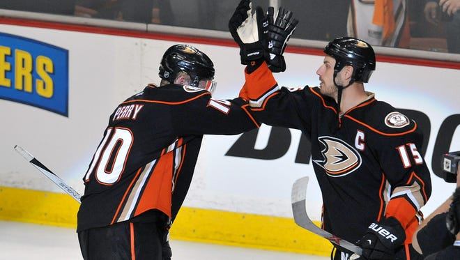 Anaheim Ducks right wing Corey Perry (10) and center Ryan Getzlaf (15) celebrate the 6-1 victory against the Calgary Flames following game one of the second round of the 2015 Stanley Cup Playoffs at Honda Center.
