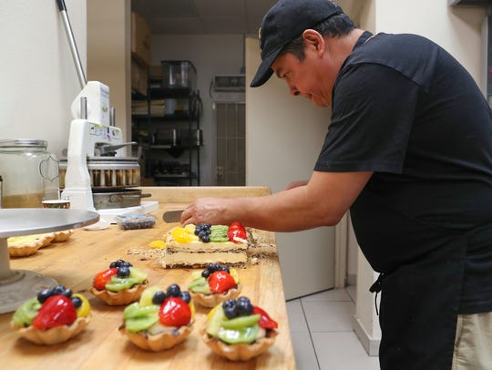 Alberto Cervantes prepares some sweets at Carousel