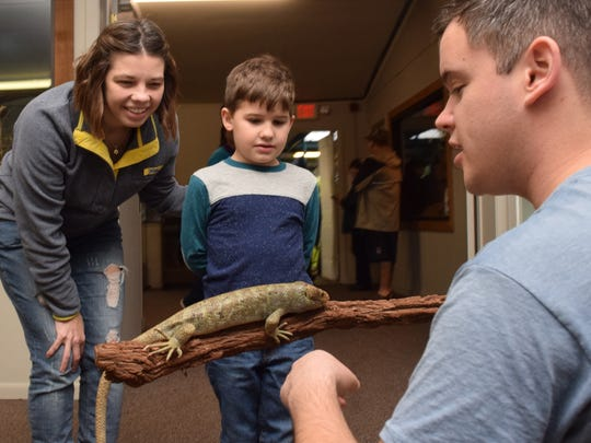 The rain didn't stop the King cake party from going on at the Alexandria Zoo Saturday, Feb. 0, 2018. Aside from eating cake, visitors were also able to get up and close with some of the zoo residents. Jessica Blood (left) and son Cohen Blood look at e prehensile tailed skink held by zoo education curator Zakary Shafer.
