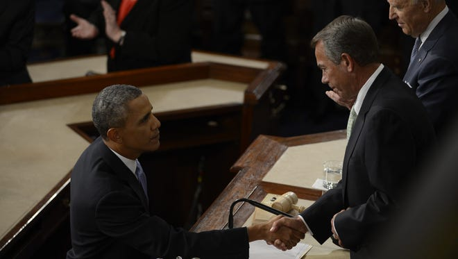 President Obama shakes hands with Speaker John Boehner after Tuesday night's State of the Union Address.