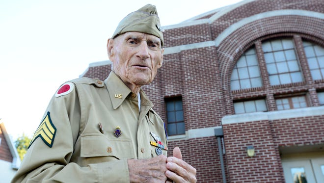 World War II veteran Jim McGrady, 97, of Fremont, stands in front of the Old Armory where he trained for his service.