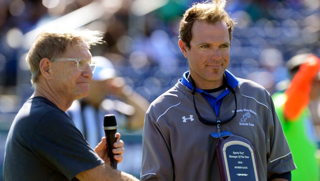 Quint Studer presents Ray Sayre with the Sports Turf Manager of the Year award Saturday during the 3rd quarter of the UWF vs West Alabama football game at Blue Wahoos Stadium on Oct. 28, 2016.