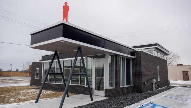 """A """"Man in the City"""" sculpture is seen on the roof of Dr. Andrea Robbins' dental office Sunday, Feb. 5, at the Michigan Dental Group in downtown Port Huron."""