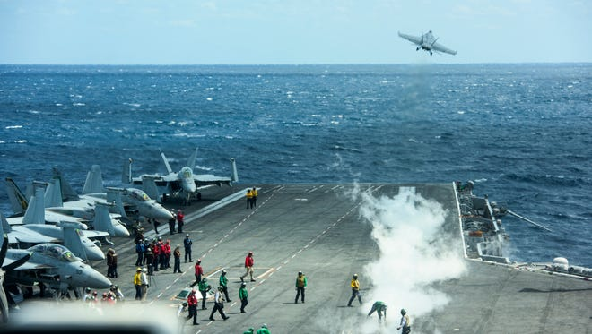 Flight operations aboard the USS Eisenhower from the vantage point of the ship's bridge.