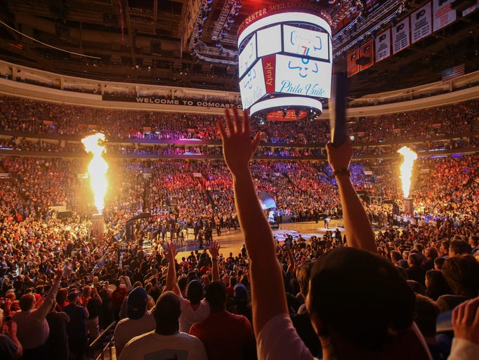 Flames shoot from jets as the Sixers starters are announced