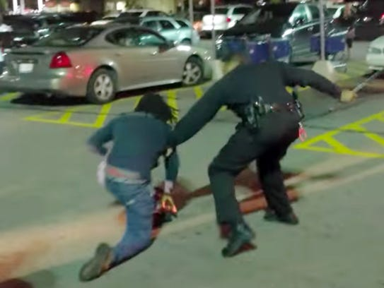 A Detroit Police officer and private citizen are seen