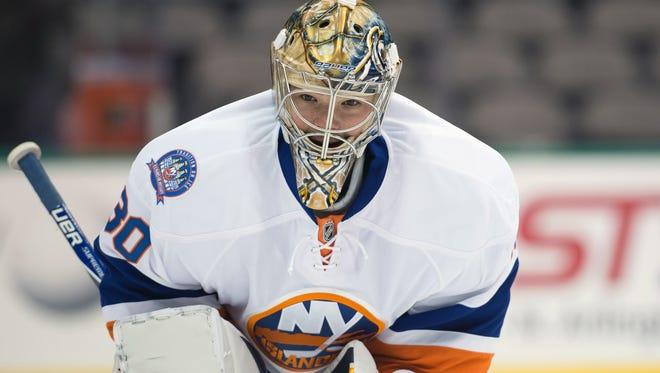 Michal Neuvirth split his time between the Buffalo Sabres and New York Islanders last season.