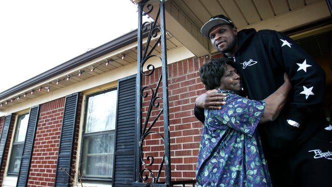 February 24, 2014 - Memphis Grizzlies' Zach Randolph gets an enormous hug from Cassie Traylor, 80, on the porch of her Binghamton home after he let her know he would be helping her with her utility bill. Randolph donated $20,000 through the Zach Randolph Community Assistance Fund to help roughly 100 households cover their utilities through the MIFA Emergency Services Plus-1 program. (Mike Brown/The Commercial Appeal)