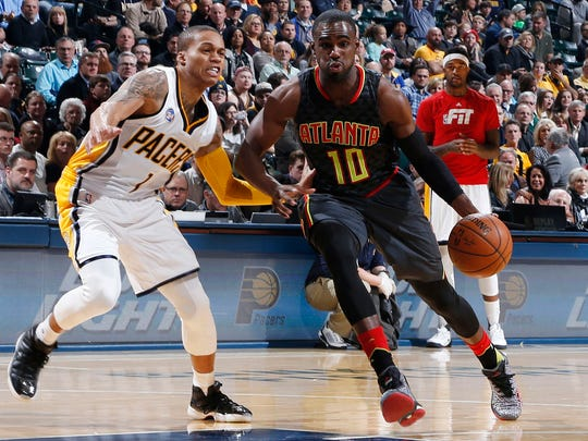 Atlanta Hawks guard Tim Hardaway (25), shown versus Joe Young, averaged a career-high 14.5 points last season. He is a possible free agent target of the Pacers.