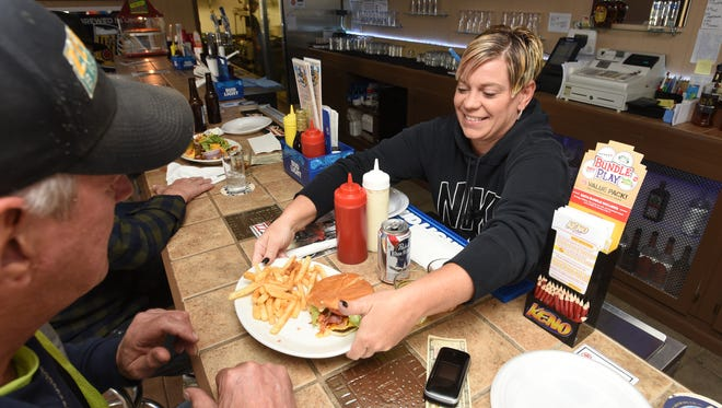 Toray Carrel serves lunch at Just 1 More on Linden Avenue in Zanesville.