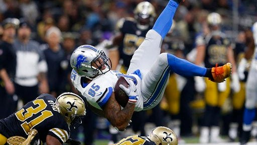 Detroit Lions tight end Eric Ebron (85) is upended by New Orleans Saints free safety Jairus Byrd (31) and strong safety Kenny Vaccaro (32) in the first half of an NFL football game in New Orleans, Sunday, Dec. 4, 2016. (AP Photo/Butch Dill)