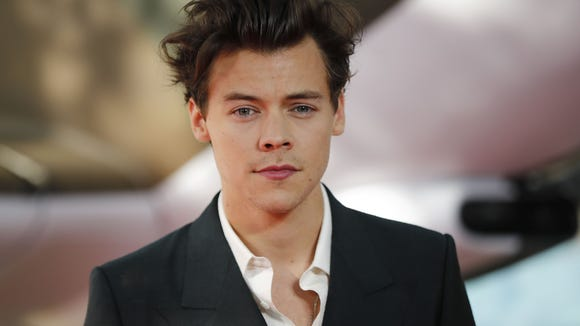 Styles famously cut his long hair for the role.
