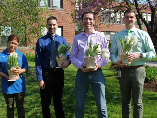 (From left) Westfield High School custodian Marina Rogel, mathematics teacher Anthony Meyers, English/journalism teacher Warren Hynes and social studies teacher Brett Curtis are this year's recipients of excellence awards.
