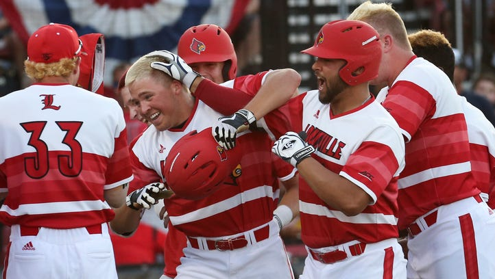 U of L's Jake Snider (20) was surrounded by elated