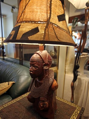 A Mud Cloth African Warrior lamp made by Rose Luangisa is on display in Mount Vernon.