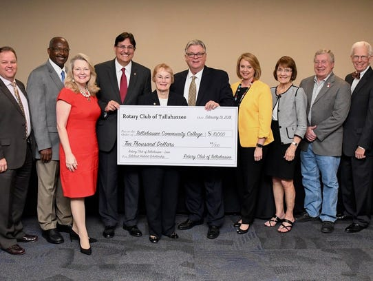 Rotary Club creates scholarship for Habitat home student.
