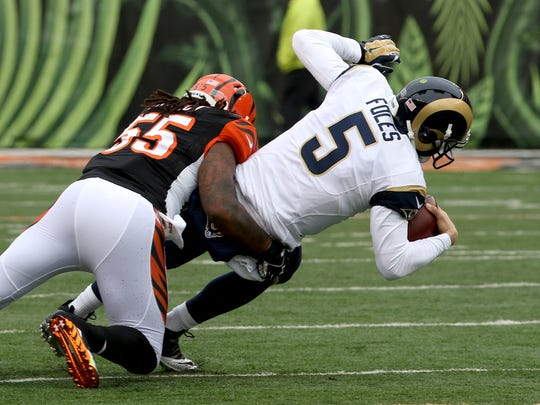 Cincinnati Bengals outside linebacker Vontaze Burfict (55) sacks St. Louis Rams quarterback Nick Foles (5) in the first half at Paul Brown Stadium Sunday  November 29,  2015.