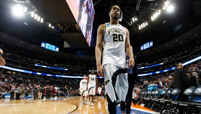 Purdue center A.J. Hammons heads off the court after a first-round men's college basketball game Thursday, March 17, 2016, in the NCAA Tournament in Denver. Arkansas-Little Rock won 85-83 in double overtime. (AP Photo/David Zalubowski)