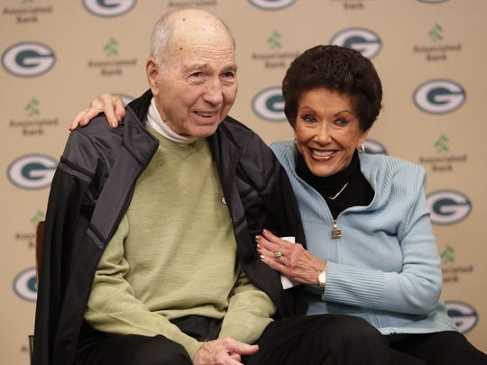 Former Green Bay Packers quarterback Bart Starr and his wife Cherry Starr pose for photos during a press conference Monday, as Bart donated several items from his career to the Packers Hall of Fame at Lambeau Field.