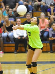 Mission Oak's Alyssa Parkison returns the ball against Redwood in a non-league volleyball match at Redwood High School.