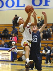 Tulare Union junior guard Kazmeir Allen attacks the hoop against the blocking of Central Valley Christian's Grant Highstreet on Tuesday in the 66th annual Polly Wilhelmsen Invitational at Redwood High School.