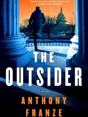 "This cover image released by Minotaur shows, ""The Outsider,"" a novel by Anthony Franze."