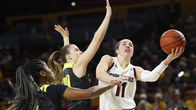 ASU's Robbi Ryan (11) goes up for a layup past Oregon's Sabrina Ionescu (20) during the first half at Wells Fargo Arena on January 23, 2018 in Tempe, Ariz.