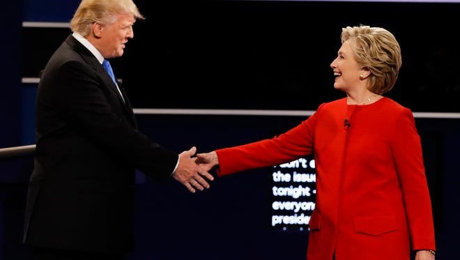 Republican presidential nominee Donald Trump and Democratic presidential nominee Hillary Clinton shake hands during the presidential debate at Hofstra University in Hempstead, N.Y., Monday.