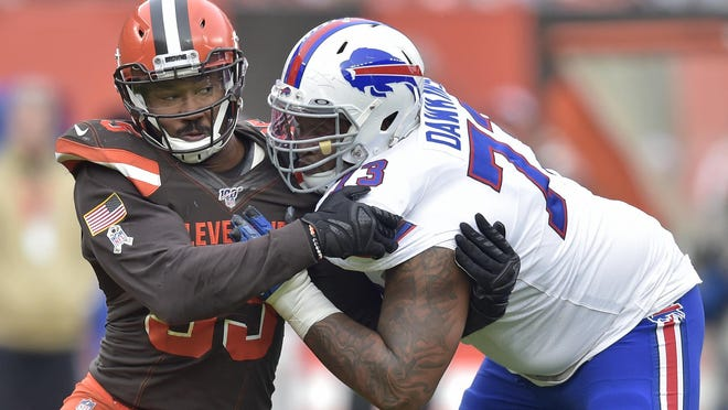 Cleveland Browns defensive end Myles Garrett, left, tries to get past Buffalo Bills offensive tackle Dion Dawkins during the first half of an NFL football game, Sunday, Nov. 10, 2019, in Cleveland.