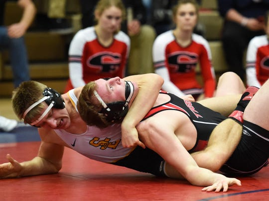 Southeast Polk's Gavin Babcock works to pin Cedar Falls Bryce Pilcher in a 170-pound match on Saturday.