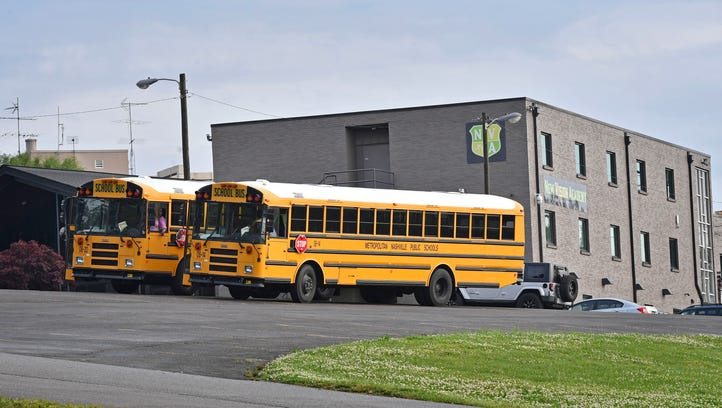 Buses sit in the parking lot of New Vision Academy