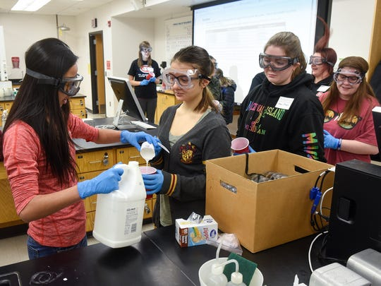 High School students line up for materials to complete a chemistry exercise Saturday, Feb. 10, during the 27th annual Horizons Conference at St. Cloud State University in St. Cloud.
