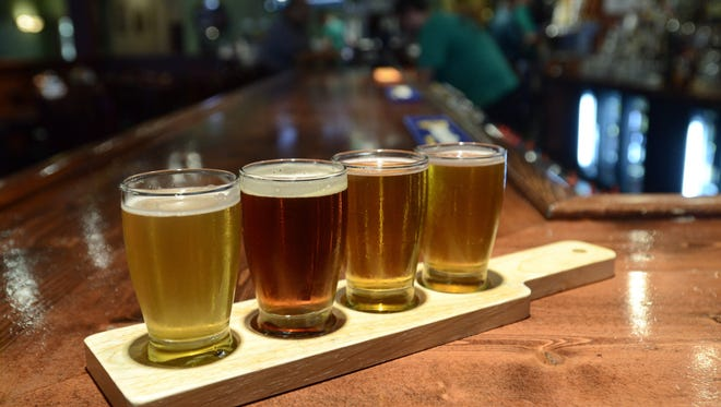 A flight of four craft beer samples: Bell's Oberon, Great Lakes Brewing Company Eliot Ness, Founder's All Day India Pale Ale and Odd Side Citra Pale Ale.