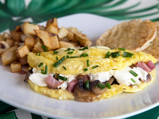 Chef Rae's Omelet features cream cheese, ham, chives and mushrooms at Meridian Cafe in Meridian Marketplace on the northeast corner of Pine Ridge and Livingston roads in North Naples.