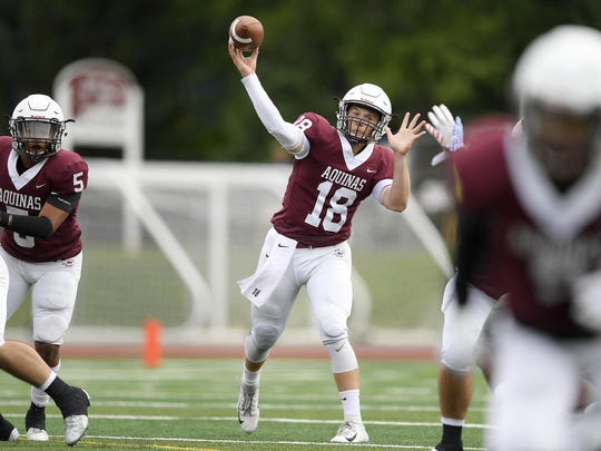 Aquinas' Tyler Szalkowski throws from the pocket in a Sept. 22 game against St. Joseph's Collegiate Institute of Buffalo. Szalkowski passed for 473 yards and seven touchdowns in his first home start.