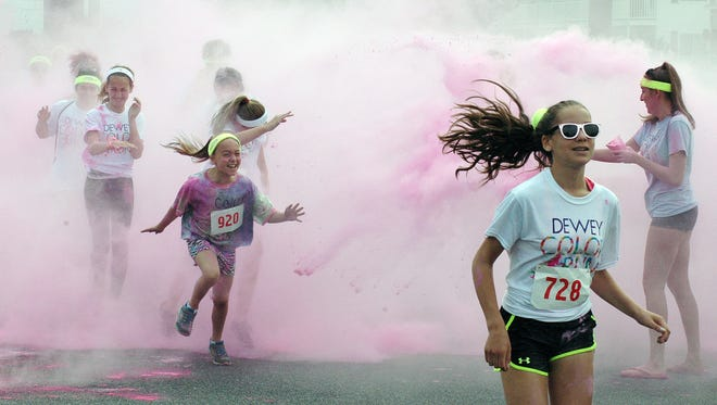 The 2nd Annual Dewey Color Run, part of the Ten Sisters Road Race Series, was held in Dewey Beach on Saturday June 6, with several hundred entrants participating in a non-competitive run/walk that had six color stations along the way. The event benefits the Southern Delaware Therapeutic Riding Association.