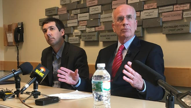 James Lyall, executive director of the Vermont ACLU, left, joined U.S. Rep. Peter Welch at a news conference at Community Health Centers of Burlington on Jan. 30, 2017.