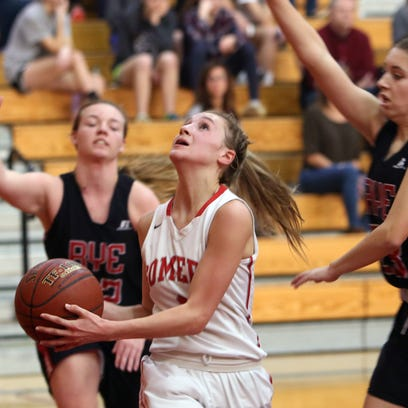 Somers' Liv Lipski (1) drives to the basket bagainst