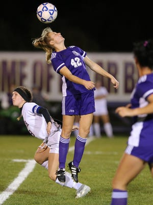 Jackson's Casey Stalder (42) goes for a header against Fitch during their D1 district semifinal game at Jackson on Monday, Oct. 21, 2019. Stalder scored a goal in Jackson's 2-1 win over Hudson on Saturday.