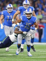 Detroit Lions wide receiver Golden Tate looks for yardage during the second half of an NFL football game against the Seattle Seahawks, Sunday, Oct. 28, 2018, in Detroit.