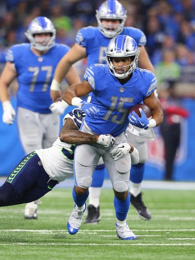 Detroit Lions wide receiver Golden Tate looks for yardage