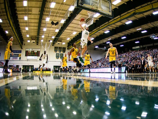 Vermont's Payton Henson (35) leaps to dunk the ball during the men's basketball game between the UMBC Retrievers and the Vermont Catamounts at Patrick Gym on Jan. 6.