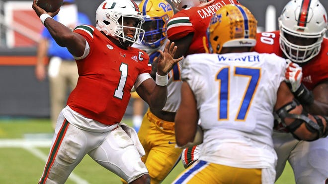 Miami quarterback D'Eriq King (1) passes against Pitts in the second half of an NCAA college football game in Miami Gardens, Fla., Saturday, Oct. 17, 2020.