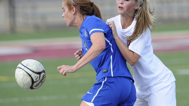 Prattville's Sydney Owens, right, was a defender turned midfielder for the Lions this past season.