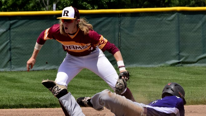 Tyler Flick (back) of Ross nails the runner coming into second base on the attempted steal.