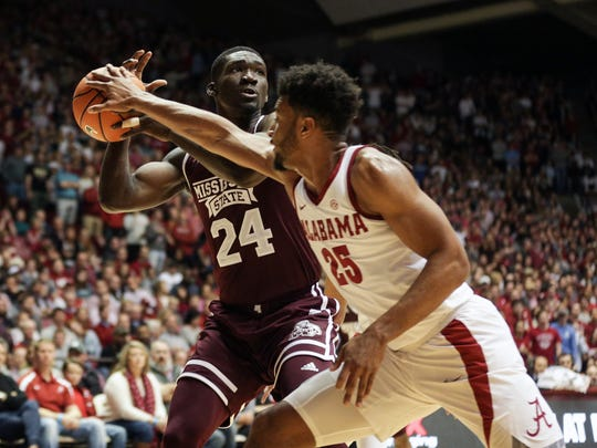 Jan 20, 2018; Tuscaloosa, AL, USA; Mississippi State Bulldogs forward Abdul Ado (24) controls the ball as Alabama Crimson Tide forward Braxton Key (25) defends during the first half at Coleman Coliseum. Mandatory Credit: Marvin Gentry-USA TODAY Sports