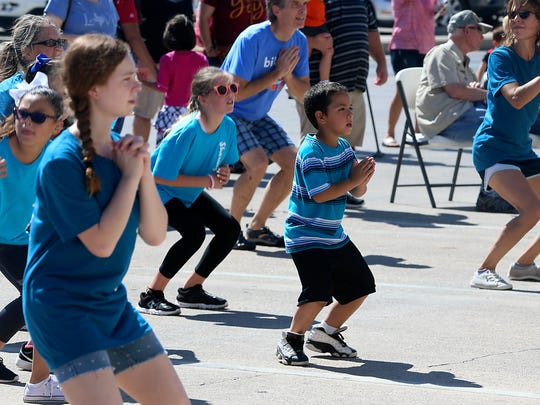 Children participate in a dance workout in front of City Hall during Ballet San Angelo'sinaugural Sharing Dance Day Saturday, Oct. 14, 2017.